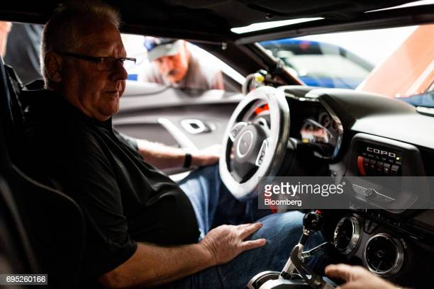 Lottery winner Kevin Mitchell sits inside his new General Motors Co Chevrolet COPO Camaro performance vehicle during a tour of the build center in...