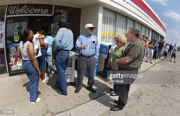 Lotterywinning hopefuls are seen as they wait in line to buy their Big Game lottery tickets outside a Citgo gas station April 16 2002 in Russell IL a...