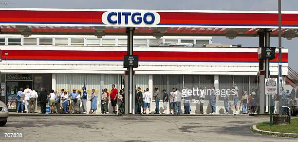 Lotterywinning hopefuls are seen in line as they wait to buy their Big Game lottery tickets at a Citgo gas station April 16 2002 in Russell Illinois...