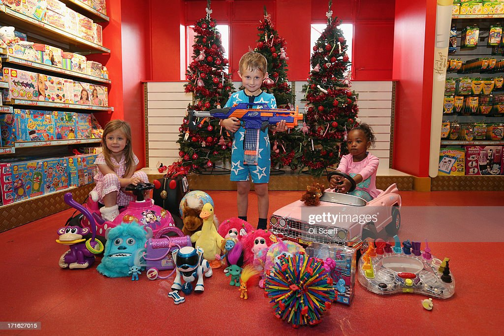 Lottie (L), aged 5, Beau (C), aged 5, and Jayla (R), aged 3, play with new toys in Hamleys toy shop on June 27, 2013 in London, England. The toys are included in Hamleys' predictions for the top selling toys for Christmas 2013.