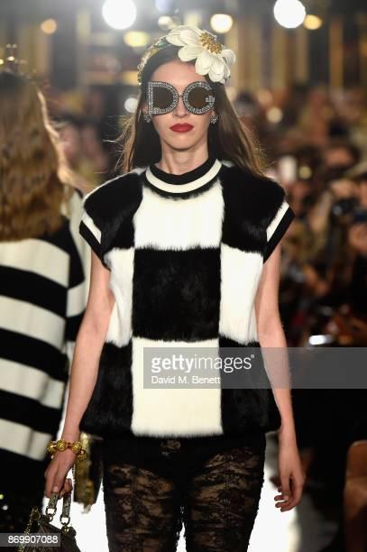 Lottie Hayes walks the Dolce Gabbana Italian Christmas catwalk show at Harrods on November 2 2017 in London England