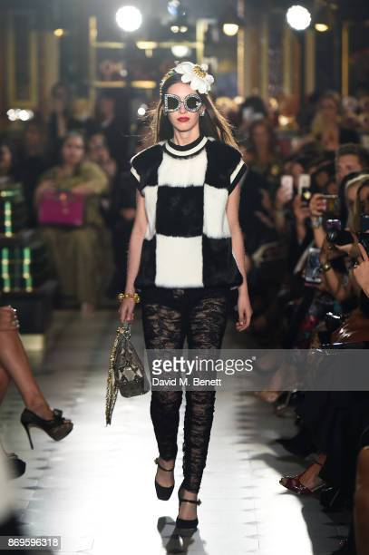 Lottie Hayes walks the runway during the Dolce Gabbana Italian Christmas at Harrods on November 2 2017 in London England