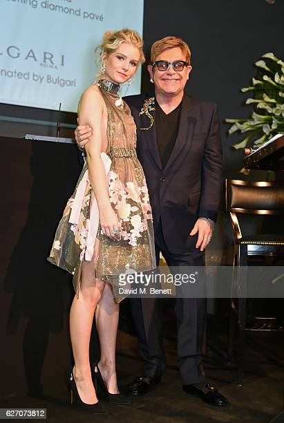 Lottie Moss and Sir Elton John attend 'The Radical Eye' dinner and private view for the Elton John Aids Foundation in association with Bulgari on...