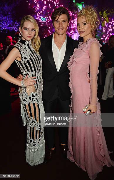 Lottie Moss Oliver Cheshire and Pixie Lott attend the Chopard Wild Party during the 69th Annual Cannes Film Festival at Port Canto on May 16 2016 in...