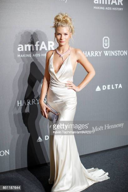 Lottie Moss walks the red carpet at the amfAR Gala Milano on September 21 2017 in Milan Italy