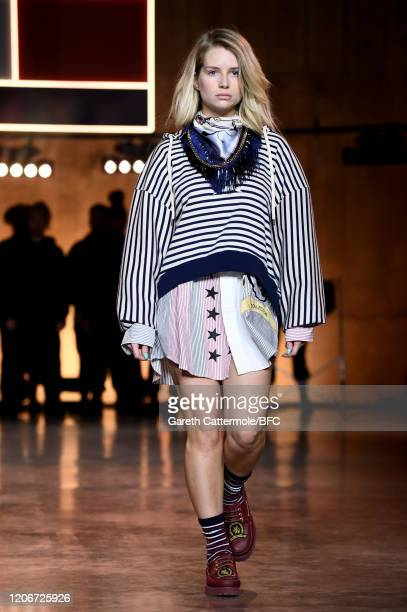 Lottie Moss walks the runway at the TommyNow show during London Fashion Week February 2020 at the Tate Modern on February 16, 2020 in London, England.
