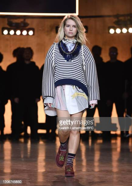 Lottie Moss walks the runway at the TommyNow show during London Fashion Week February 2020 at the Tate Modern on February 16 2020 in London England