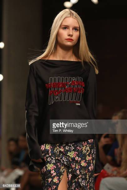 Lottie Moss walks the runway at the Topshop Unique show during the London Fashion Week February 2017 collections on February 19 2017 in London England