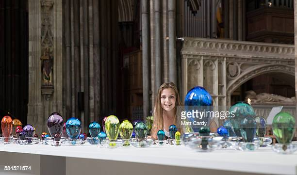 Lottie Pedder from Salisbury Cathedral poses for a photograph with Sailing on a river of crystal lights, in to sea of dew by artist Louis Thompson,...