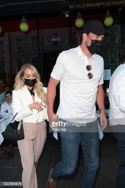 Lottie Tomlinson and Lewis Burton seen leaving Cambio de Tercio restaurant in Old Brompton Road on June 10, 2021 in London, England.