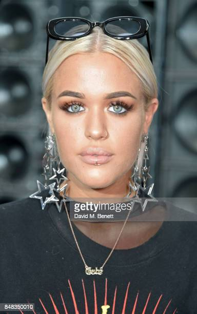 Lottie Tomlinson attends the Versus SS18 catwalk show during London Fashion Week September 2017 at Central St Martins on September 17 2017 in London...