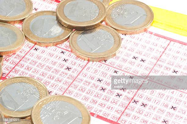 lotto - lottoschein mit münzen - lotterytickets stock pictures, royalty-free photos & images