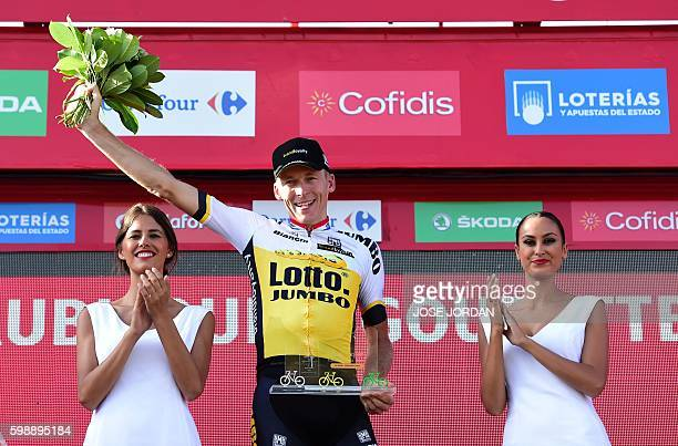 Lotto NL Jumbo's Dutch cyclist Robert Gesink celebrates on the podium after winning the 14th stage of the 71st edition of La Vuelta Tour of Spain a...