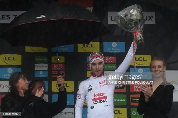 Lotto Soudal rider Belgium's Bjorg Lambrecht celebrates his best young's white jersey on the podium of the seventh stage of the 71st edition of the...