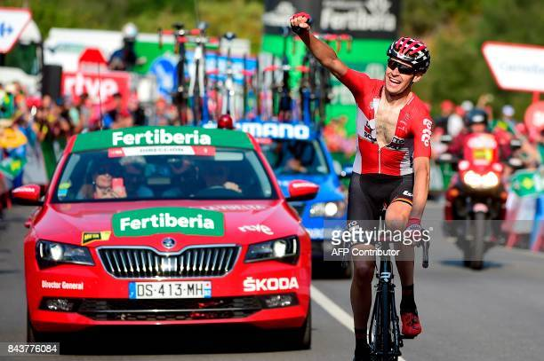 Lotto Soudal's Belgian cyclist Sander Armee celebrates as he crosses the finish line of the 18th stage of the 72nd edition of 'La Vuelta' Tour of...