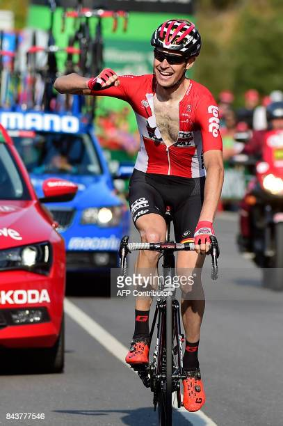 Lotto Soudal's Belgian cyclist Sander Armee celebrates as he crosses the finish line to win the 18th stage of the 72nd edition of 'La Vuelta' Tour of...