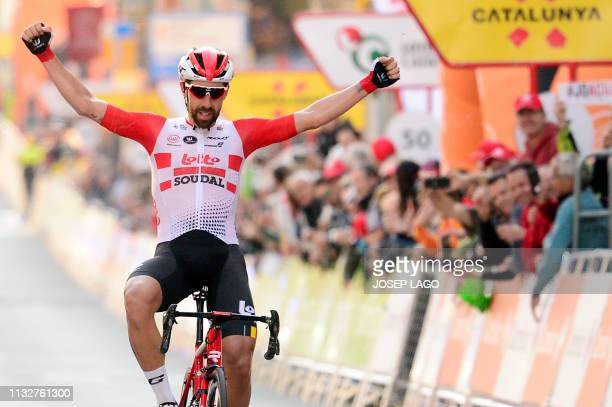 Lotto Soudal's Belgian rider Thomas De Gendt celebrates as he crosses the finish line winning the first stage of the 99th Volta Catalunya 2019 a 164...