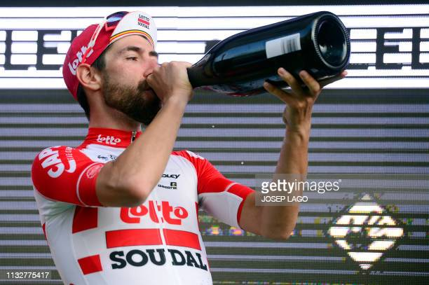 Lotto Soudal's Belgian rider Thomas De Gendt drinks cava wine as he celebrates on the podium after winning the first stage of the 99th Volta...