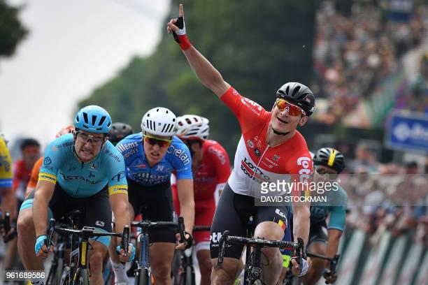 Lotto Soudal's German rider Andre Greipel celebrates as he wins the sprint past Astana Pro Team's Italian rider Riccardo Minali on the finish line of...
