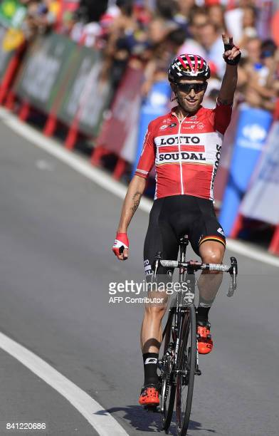 Lotto Soudal's Polish cyclist Tomasz Marczynski celebrates as he crosses the finish line of the 12th stage of the 72nd edition of 'La Vuelta' Tour of...