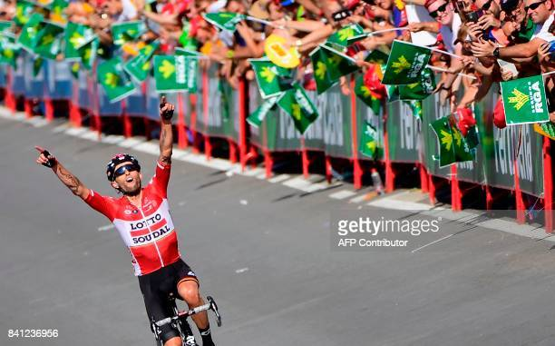 Lotto Soudal's Polish cyclist Tomasz Marczynski celebrates as he crosses the finish line of the 12th stage of the 72nd edition of La Vuelta Tour of...