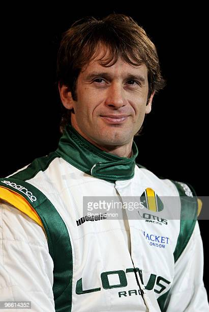 Lotus driver Jarno Trulli of Italy poses with the new Lotus T127 F1 car during the Lotus F1 launch at The Royal Horticultural Halls on February 12...