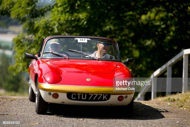 Lotus Elan Sprint driven by Mike Crabtree at the top of The Test Hill during The Brooklands Double Twelve Motorsport Festival at Brooklands Racing...