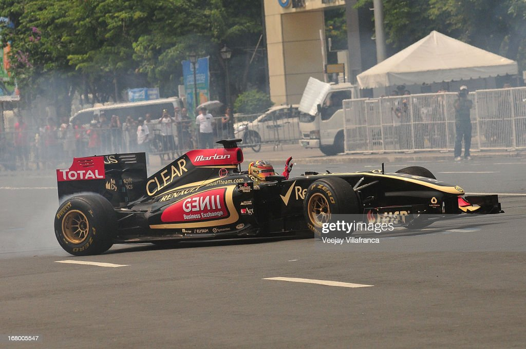 Lotus F1 junior driver Marlon Stockinger exhibits his driving skills during the car demo at the Quirino grandstand on May 4, 2013 in Manila, Philippines. The Formula 1 Lotus team was in the Philippines for a promotional tour and also hoping to gather support for their Filipino-Swiss junior driver and also to drum up interest in the sport.
