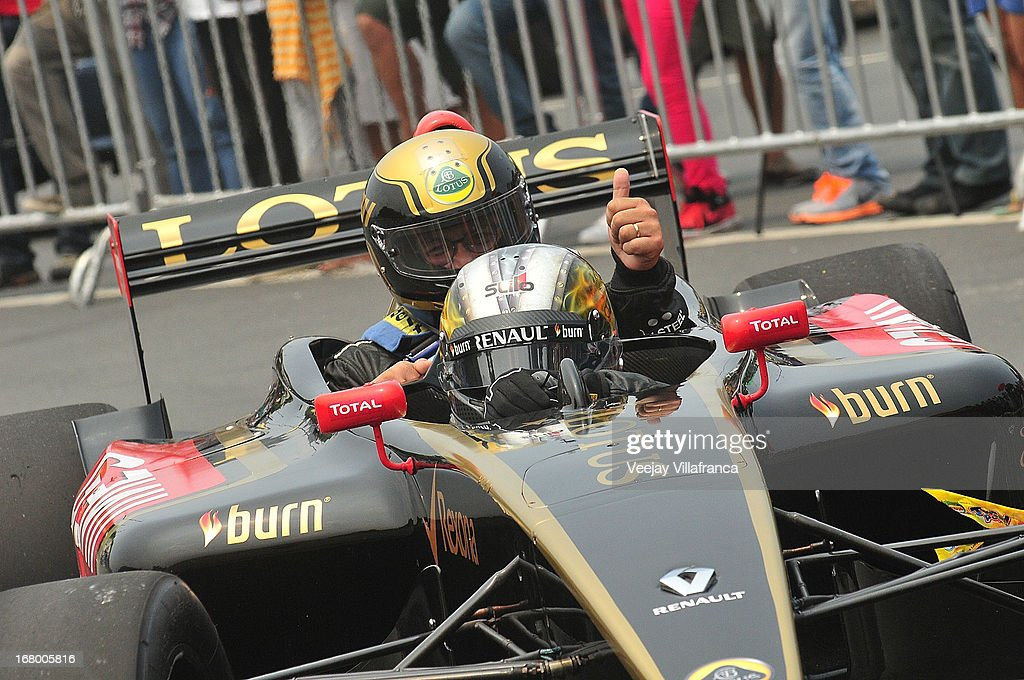 Lotus F1 reserve driver Davide Valsecchi drives around Philippime Customs Commissioner Ruffy Biazon during the demo run at the Quirino grandstand on May 4, 2013 in Manila, Philippines. The Formula 1 Lotus team was in the Philippines for a promotional tour and also hoping to gather support for their Filipino-Swiss junior driver and also to drum up interest in the sport.