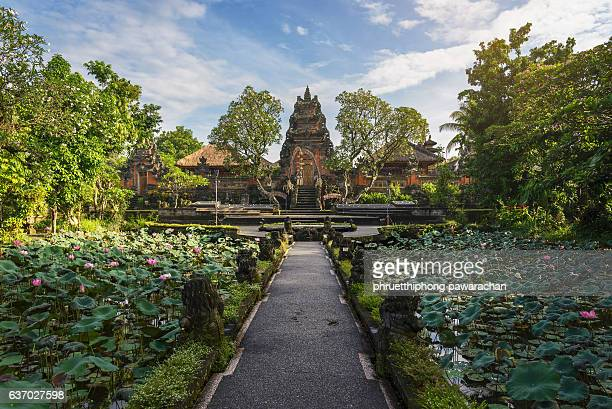 lotus pond and pura saraswati temple in ubud, bali, indonesia. - saraswati stock photos and pictures