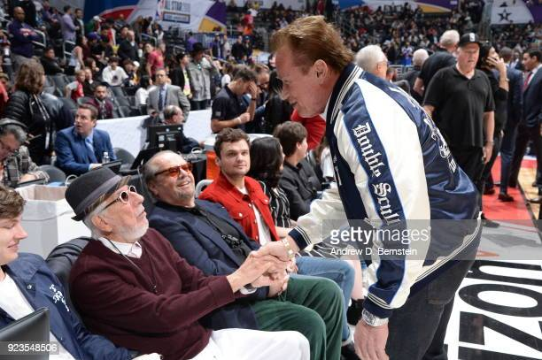 Lou Adler shakes hands with Arnold Schwarzenegger during the NBA AllStar Game as a part of 2018 NBA AllStar Weekend at STAPLES Center on February 18...