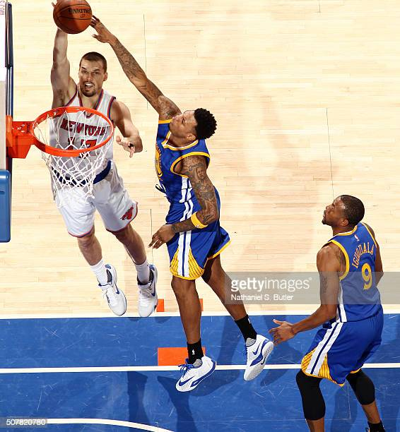 Lou Amundson of the New York Knicks goes to the basket against the Golden State Warriors on January 31 2016 at Madison Square Garden in New York City...