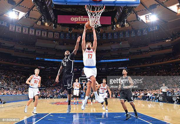 Lou Amundson of the New York Knicks goes up for the dunk against the Brooklyn Nets in a preseason game at Madison Square Garden on October 8 2016 in...
