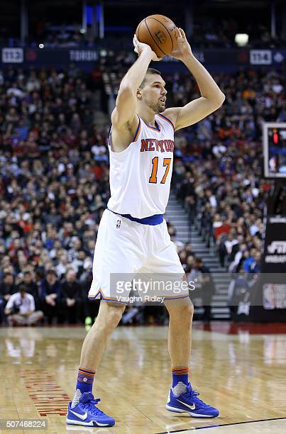 Lou Amundson of the New York Knicks passes the ball during an NBA game against the Toronto Raptors at the Air Canada Centre on January 28 2016 in...