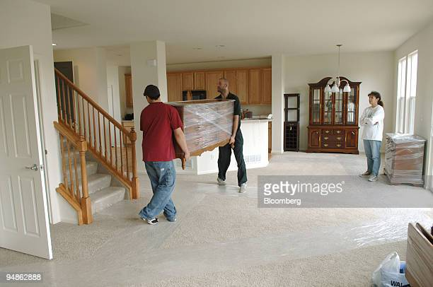Lou Ann Sandoval right watches movers carry a piece of furniture in her new home Thursday October 27 in Littleton Colorado Newhome sales rose in...
