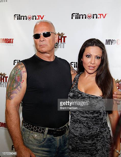 Lou Ballera and Amy Fisher attend Celebrity Fight Night Official Press Conference at 9021GO Showroom on September 26 2011 in Beverly Hills California