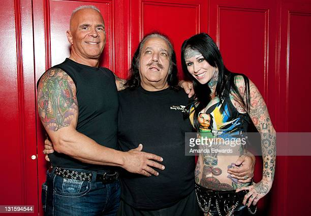 Lou Bellera Ron Jeremy and model Michelle Bombshell McGee pose backstage at the FilmOn Celebrity Fight Night at Avalon on November 5 2011 in...