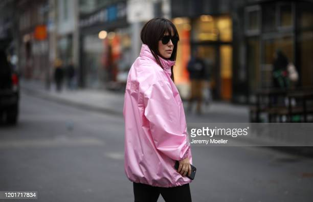 Lou Beyer wearing Balenciaga jacket, shades and sneaker and Puma pants on January 24, 2020 in Cologne, Germany.