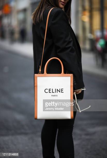 Lou Beyer wearing Celine bag, Prada boots, Cos pants, Helmut Lang shirt and Zara blazer on March 06, 2020 in Cologne, Germany.