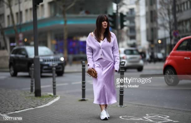Lou Beyer wearing Edited sweater and skirt Nike sneaker and Bottega Veneta mini pouch on January 24 2020 in Cologne Germany