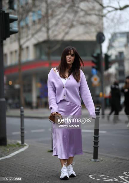 Lou Beyer wearing Edited sweater and skirt, Nike sneaker and Bottega Veneta mini pouch on January 24, 2020 in Cologne, Germany.