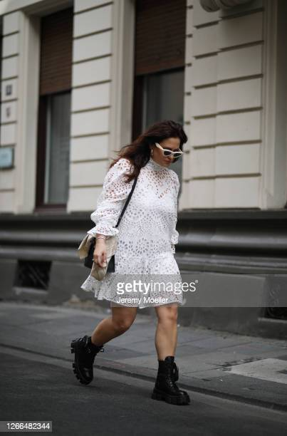 Lou Beyer wearing Hermes bag Prada boots Celine shades and HM dress on August 14 2020 in Cologne Germany