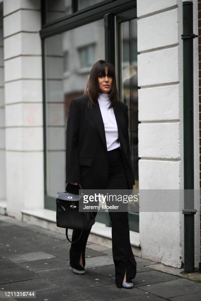 Lou Beyer wearing Hermes bag, Prada heels, Zara blazer, & other stories pants and Acne Studios shirt on March 06, 2020 in Cologne, Germany.
