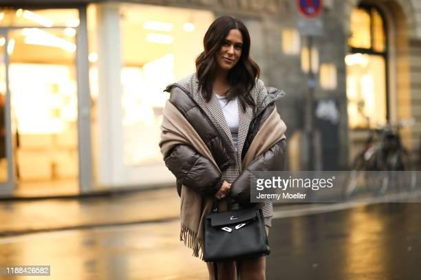 Lou Beyer wearing Jil Sander Boots, Hermes Kelly bag, Acne Studio scarf, weekday jacket, H&M two piece on November 18, 2019 in Cologne, Germany.