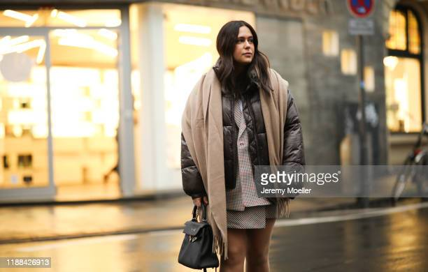 Lou Beyer wearing Jil Sander Boots Hermes Kelly bag Acne Studio scarf weekday jacket HM two piece on November 18 2019 in Cologne Germany