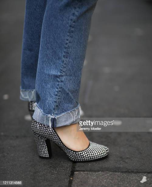 Lou Beyer wearing Prada heels, Bottega Veneta pouch, Mother Denim jeans and Acne Studios flannel on March 06, 2020 in Cologne, Germany.