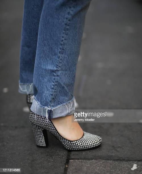 Lou Beyer wearing Prada heels Bottega Veneta pouch Mother Denim jeans and Acne Studios flannel on March 06 2020 in Cologne Germany