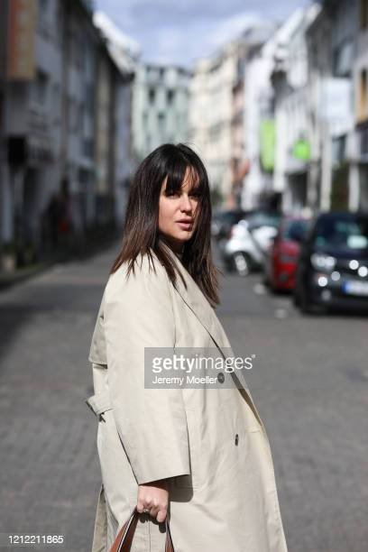 Lou Beyer wearing Weekend Max Mara trenchcoat on March 13, 2020 in Cologne, Germany.