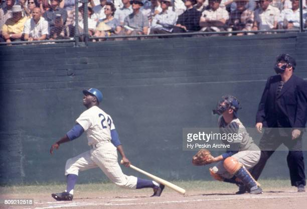 Lou Brock of the Chicago Cubs swings at a pitch during an MLB Spring Training game against the Los Angeles Dodgers circa April 1962 in Mesa Arizona