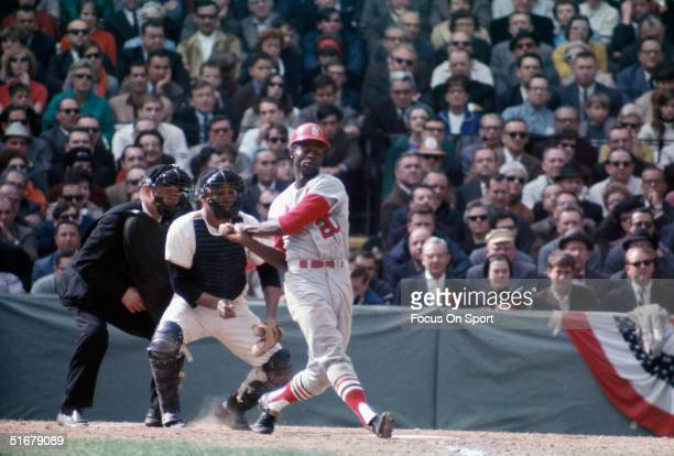 Lou Brock outfielder for the St Louis Cardinals swings against the Boston Red Sox during the World Series at Fenway Park on October 1967 in Boston...